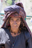 Beggar old woman begs for money from a passerby in Srinagar, Kashmir. India. SRINAGAR, INDIA - JUNE 12, 2015: Unidentified beggar woman begs for money from a Stock Images