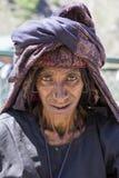 Beggar old woman begs for money from a passerby in Srinagar, Kashmir. India. SRINAGAR, INDIA - JUNE 12, 2015: Unidentified beggar woman begs for money from a Stock Image