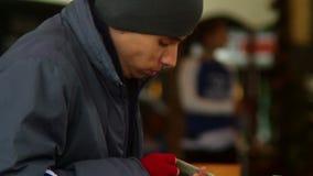 Beggar poor man counting his last money, stolen dollars, eating. Stock footage stock footage