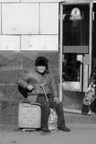 Beggar. The poor man sits on the street royalty free stock photo