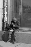 Beggar. The poor man sits on the street royalty free stock image