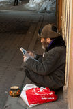 Beggar. The poor man sits on the street Royalty Free Stock Photography
