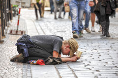 Beggar. In the streets of Prague. In Prague you see many people begging for money in the city on the Charles Bridge and the Old Town royalty free stock photo