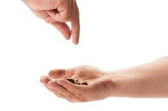 Beggar receiving coins Stock Photography