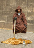 A beggar showing levitation at the center of Pragu Royalty Free Stock Photography
