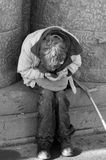 Beggar. The sick man considers alms on the city street stock images