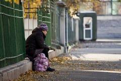 Beggar on the sidewalk Royalty Free Stock Image