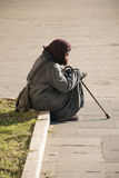 Beggar. A beggar on the sidewalk of a street in Rome Stock Photography