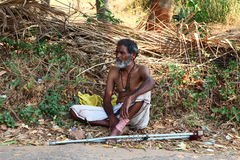 Homeless, India. A beggar sits on the ground and begging.  Picture taken March 9, 2013 Royalty Free Stock Image