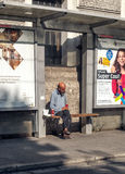 Beggar sitting on a bench Royalty Free Stock Photography