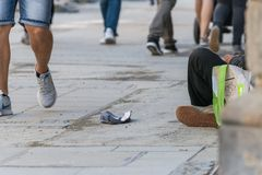 Beggar sitting in a pedestrian zone, Germany stock photos
