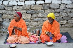 Beggar sitting in the way of badrinath temple stock photography