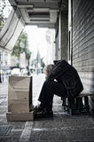 Beggar in the street Stock Images