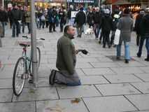 Beggar on street of Dresden, Germany Stock Photo
