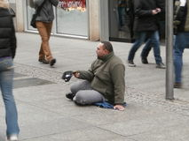 Beggar on street of Dresden, Germany Stock Images