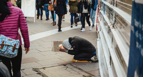 Beggar in the street of France Royalty Free Stock Photo