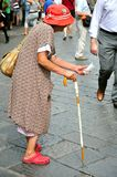 Beggar on the streets of Florence, Italy Royalty Free Stock Images