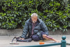 Beggar on the streets Stock Photos
