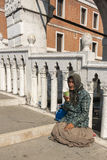 Beggar Venice, Italy. Beggar woman on a bridge in Venice Italy begging from passing people and tourists stock photography