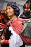 Beggar Woman. A small beggar at the Otavalo Market in Ecuador Royalty Free Stock Image