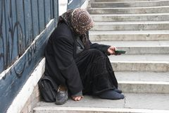 Beggar woman. Royalty Free Stock Photo