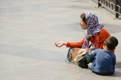 Beggar woman royalty free stock image