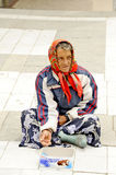 A beggar woman begging on a pedestrian street in Prilep, Macedonia. Royalty Free Stock Image