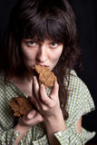 Beggar woman eating bread Royalty Free Stock Photo