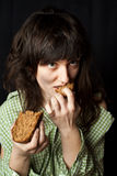 Beggar woman eating bread Stock Photography