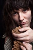 Beggar woman with a piece of bread Stock Photos