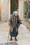 Beggar woman in the street of old Budva in Montenegro Royalty Free Stock Photo