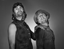 Beggars. Two happy beggars, studio photo stock images