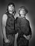 Beggars. Two strong beggars ready to face the future, studio photo stock images
