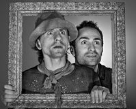 Beggars. Two beggars looking in to the future through a frame royalty free stock image
