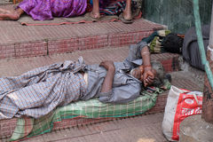 Beggars in front of Nirmal Hriday, Home for the Sick and Dying Destitutes in Kolkata. Beggars in front of Nirmal Hriday, Home for the Sick and Dying Destitutes royalty free stock photo