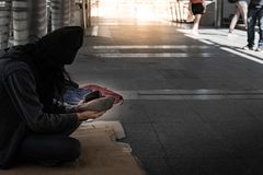 Beggars need help to sustain life stock images