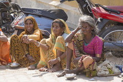 Beggars indian women waits for alms on a street in Pushkar, India Royalty Free Stock Photography