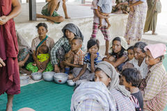Beggars in Queue. Beggars waiting on gifts from people in Bagan during the holidays giving gifts to monks, Myanmar Royalty Free Stock Photography