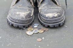 Begger And Coins Royalty Free Stock Photos