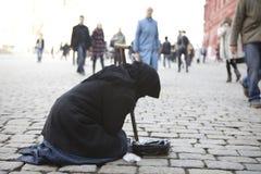 Begger dans le squere rouge à Moscou. photos libres de droits