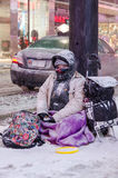 Begger in Downtown during a snowfall in Toronto Stock Images