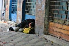 Begger sleeps in the city center. stock photo
