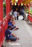 Begger wait for donation in Kek Lok Si temple in Penang Royalty Free Stock Photography