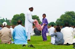 Beggers på den Eid dagen royaltyfria bilder