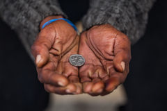 Begging. A old African man is begging for money Royalty Free Stock Photos