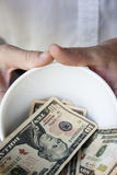 Begging bowl. A man using a begging bowl to help him get on with life Royalty Free Stock Images