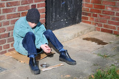 Begging boy. Boy begging, hoping for a better life royalty free stock images