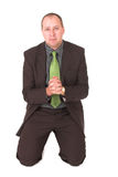 Begging businessman #2. Begging for business or to be forgiven Royalty Free Stock Images