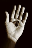 Begging hand with some coins Royalty Free Stock Photography