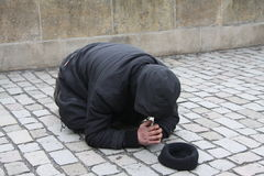 Begging. Or panhandling is the practice of imploring others to grant a favor, often a gift of money, with little or no expectation of reciprocation. Beggars may Stock Images